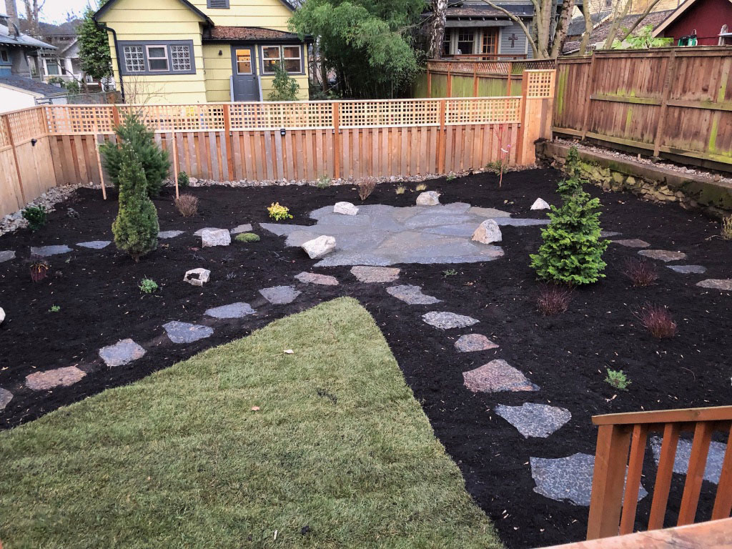 Flagstone patio with boulders and stepping stone paths.
